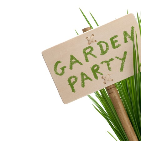 garden party: invitation card to a garden party, one wooden panel isolated on a white background with green plan Stock Photo