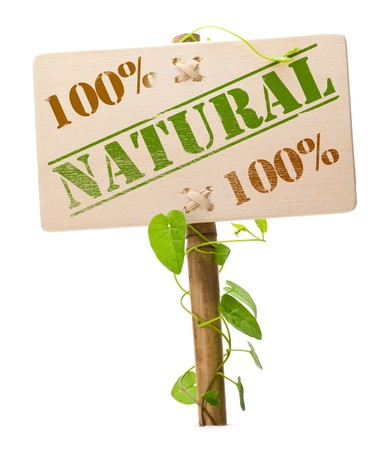 natural product: 100 percent natural sign message on a wooden panel and green plant - image is isolated on a white background