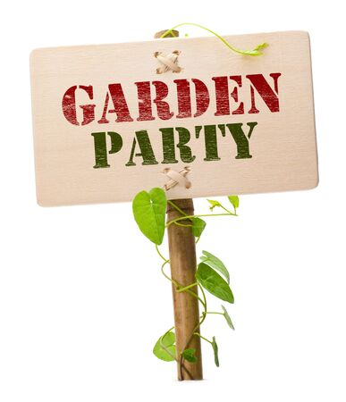 garden parties: garden party invitation card message on a wooden panel and green plant - image is isolated on a white background Stock Photo