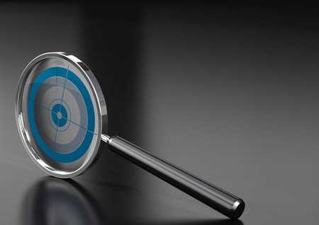 solutions: magnifying glass  with a target in it, over a black background with reflection Stock Photo