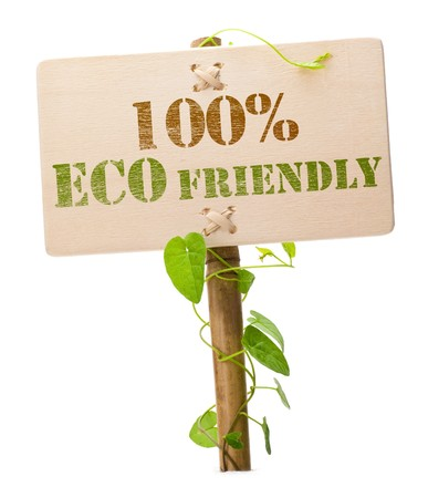 environmental friendly: eco friendly sign message on a wooden panel and green plant - image is isolated on a white background