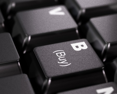 buy written on a black key - keyboard photo