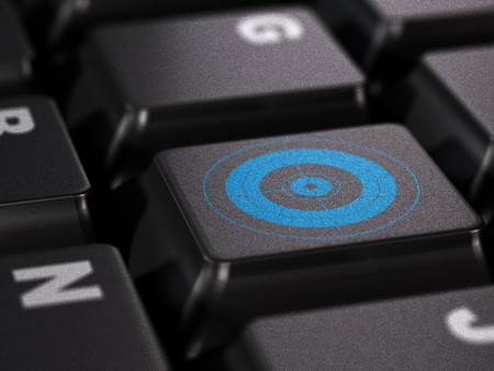 blue target on a black keyboard Stock Photo - 7647500