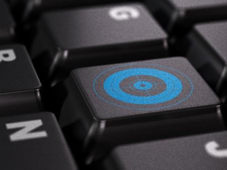 blue target on a black keyboard Stock Photo - 7647500