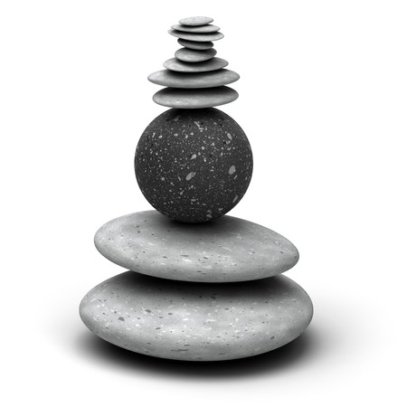wholeness: pebbles stack over a white background