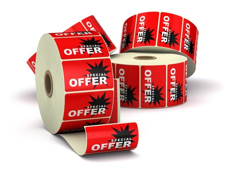 red special offer stickers on a bobbin, image is isolated over a white background with shadow Stock Photo - 7837796