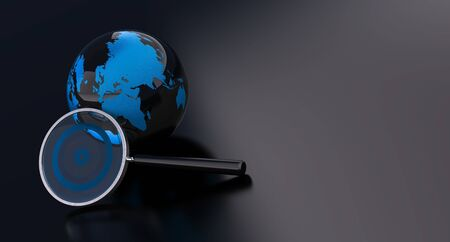 earth and magnifying glass over a black background photo