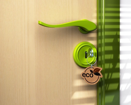 Close up of a door and a key ring where its written the word eco, the lock is green there is a copy space on bottom left photo