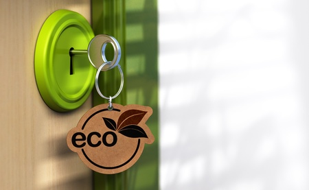 Close up of a door and a key ring where its written the word eco, the lock is green there is a copy space on the right Stock Photo