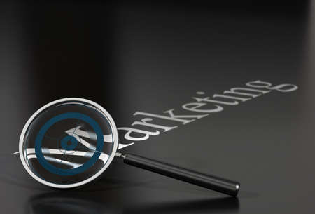 marketing word over a black background withe a magnifying glass and a blue target inside photo
