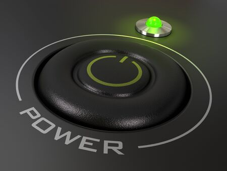 power button on a personal computer, the green led is light up, image is over a black background photo