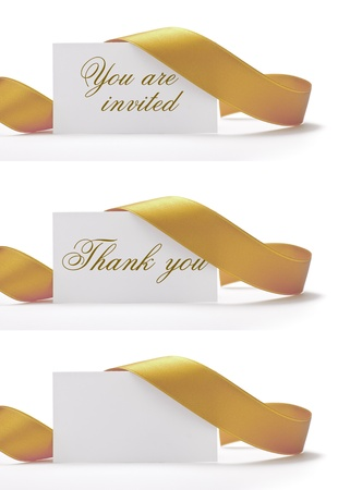 invitations and greeting cards over a white background, vhere its written you are invited, and thank you. There is a golden ribbon around it photo