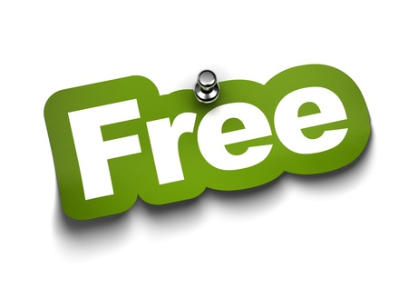 freebie: free sticker fixed on a white wall with a thumbtack Stock Photo