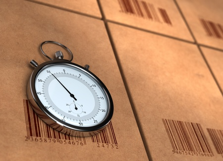 just in time: stopwatch over many carton boxes with barecodes, the chronometer is positioned on the left side, the right side is blurred for copy space - 3D render Stock Photo