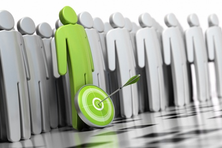 employing: 3d green character with a dart in front of his legs with an arrow hitting the center. there is many other grey character at the backside they are blurred Stock Photo