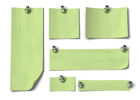 Set of green notes with different sizes, large, long. fixed by a thumbtack onto a white wall Stock Photo - 10932991