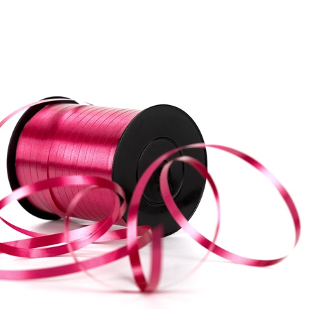 bobbin of pink ribbon for gift. Image over white background photo
