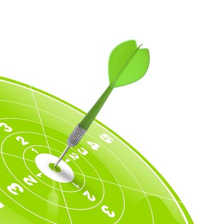 Wurfpfeil trifft die Mitte eines grüne Zielobjekt