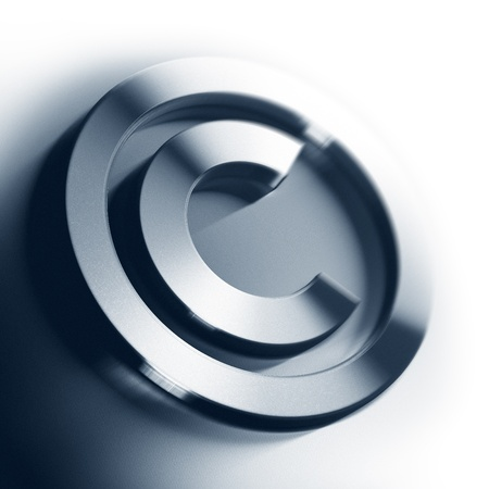 intellectual property: metal copyright symbol onto a white background square image with blur, border of a page