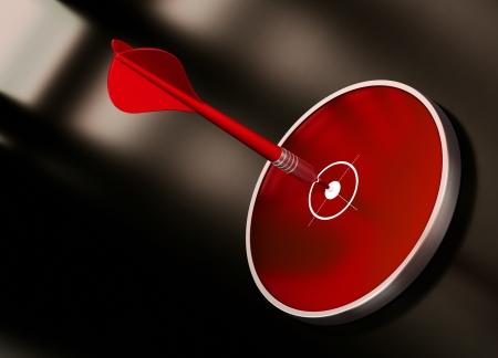 competitividad: tiro al blanco con un dardo rojo golpear el centro de un blanco moderno. La imagen est� sobre un fondo negro oscuro y marr�n. No hay espacio de la copia en la parte inferior izquierda de la imagen Foto de archivo