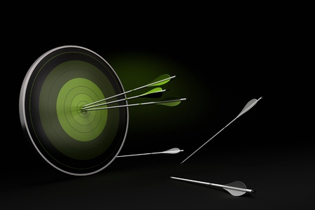 dexterity: green target onto a black background with three arrows reaching their goal, and whites arrows on the floor failed to reach their objective. Stock Photo