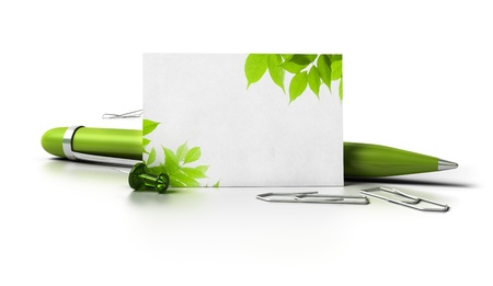 blank business card with leaves at the corner, ballpoint pen thumbtack and paperclips over a white background with reflection  photo