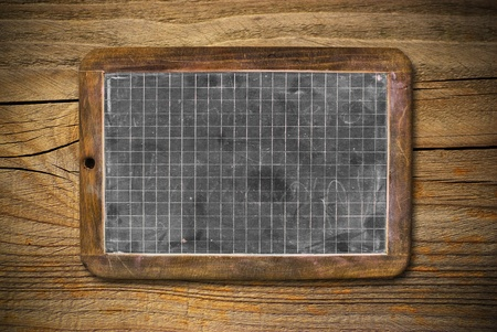 old horizontal blackboard onto wooden background, grungy style Stock Photo - 12894103