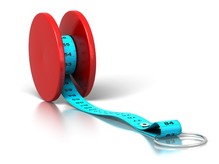 plastic tape measure rolled on a yo-yo over a white background photo