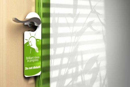 do not disturb: green door hanger onto a handler with room for text on the wall at the right side  On the sign it