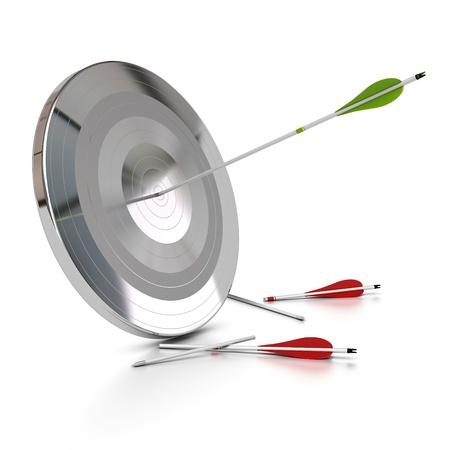 un blanco de metal atravesado por una flecha verde, hay dos flechas rojas rotas en el piso, fondo blanco photo