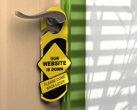 informative: website down written onto a yellow door hanger, informative message, green border, white wall  Stock Photo