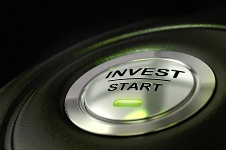investment solutions: abstract invest start button, metal material, green color and black textured background  Focus on the main word and blur effect  Investment concept