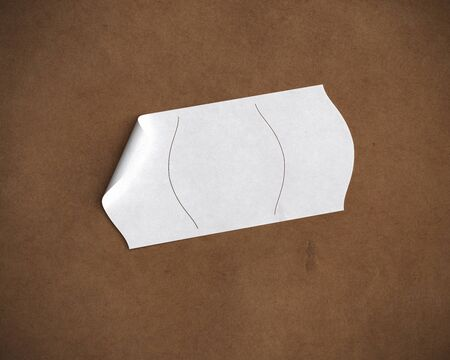 scored: white price tag over brown recycled paper, room for text Stock Photo