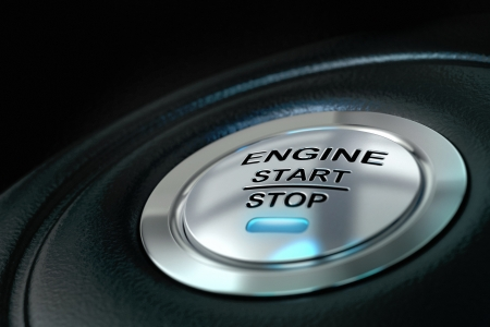 start up: Car engine start and stop button with blue light anf black textured background, close up and details on the text Stock Photo
