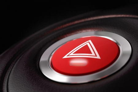 pushed: pushed red warning button with triangle pictogram, close up view and flasher light