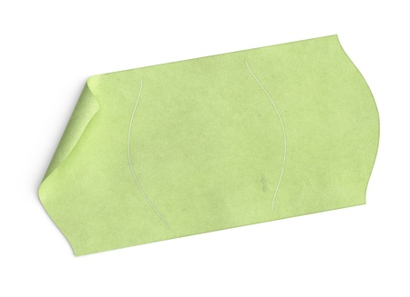 price tag, blank green sticker over white background with texture, and bended corner photo