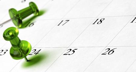 schedules: documento de planificaci�n con la chincheta verde inserta en el n�mero 24, con espacio para texto y efecto de desenfoque Foto de archivo