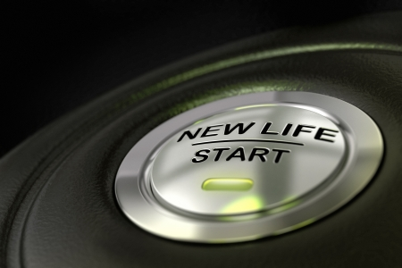 pushed: pushed new life start button over black background, blue light, changing of life concept