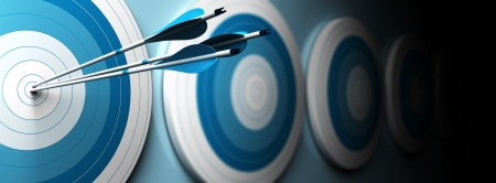 many blue targets and three arrows hitting the center of the first one, horizontal image, banner style  Stock Photo