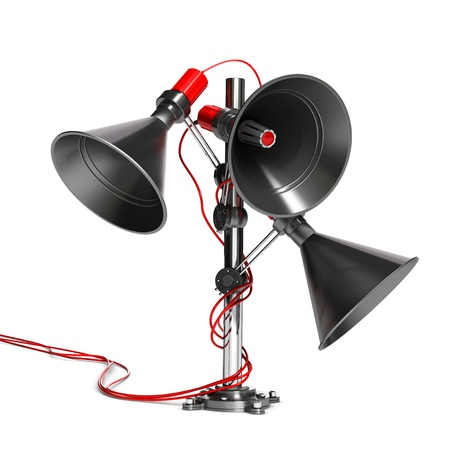 three megaphones fixed onto a metallic pole  Earch one are positioned in a different direction  White background photo