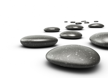 zen stones: many pebbles on a white floor, stones are black with grey dots, there is a blur effecton the background, the front stone is clear