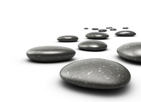 piedras zen: muchos guijarros sobre un suelo blanco, las piedras son de color negro con puntos grises, hay una effecton desenfoque del fondo, la piedra delante es claro