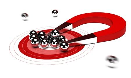 calamita: magnete a ferro di cavallo rosso attirando alcune palle cromo, sfondo bianco