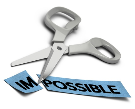 overcoming adversity: word impossible cut in two parts im and possible  Scissors at the background over white