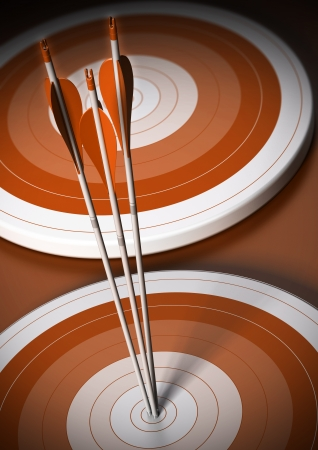 superiority: two orange targets in a row, three arrows hits the first one in the center, vertical background Stock Photo