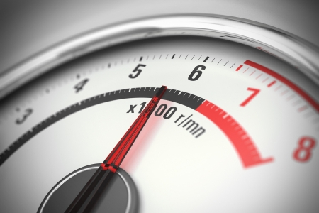 rev: close up of a tachometer with blur effect Stock Photo