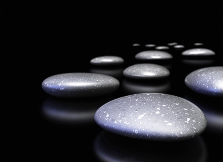 regularity: many pebbles in a row over black background with reflection, decorative border Stock Photo