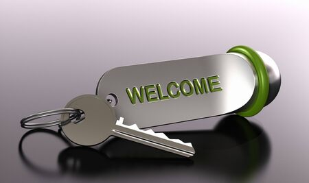 reservation: key and keyring of an hotel with the word welcome over grey background with blur effect - depth of field Stock Photo