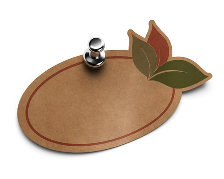 eco friendly label, kraft paper with drawing of leaves fixed on a white wall with metal thumbtack  photo
