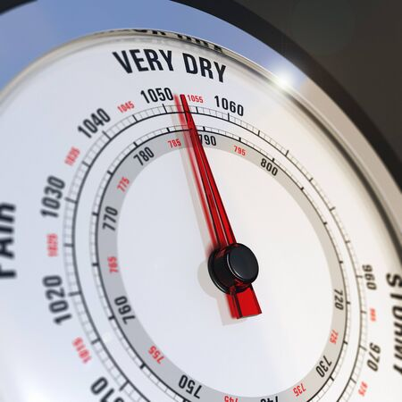Close up of a barometer dial with needle set to very dry, concept of global warming and climate change photo